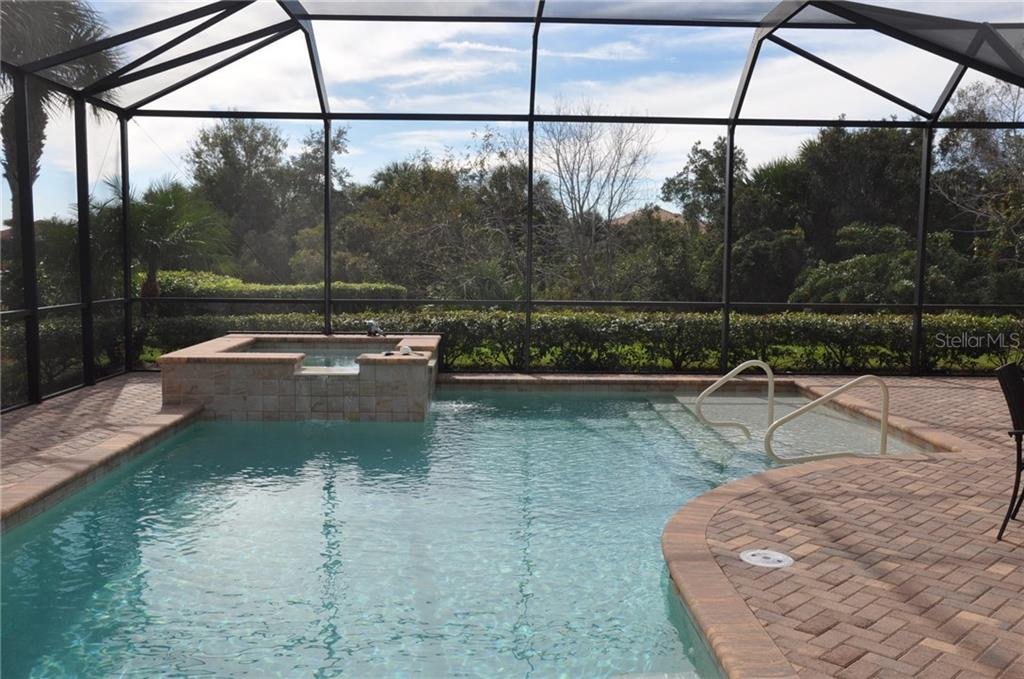 Pool looking toward the family room and pool bath. - Single Family Home for sale at 190 Portofino Dr, North Venice, FL 34275 - MLS Number is N5915077