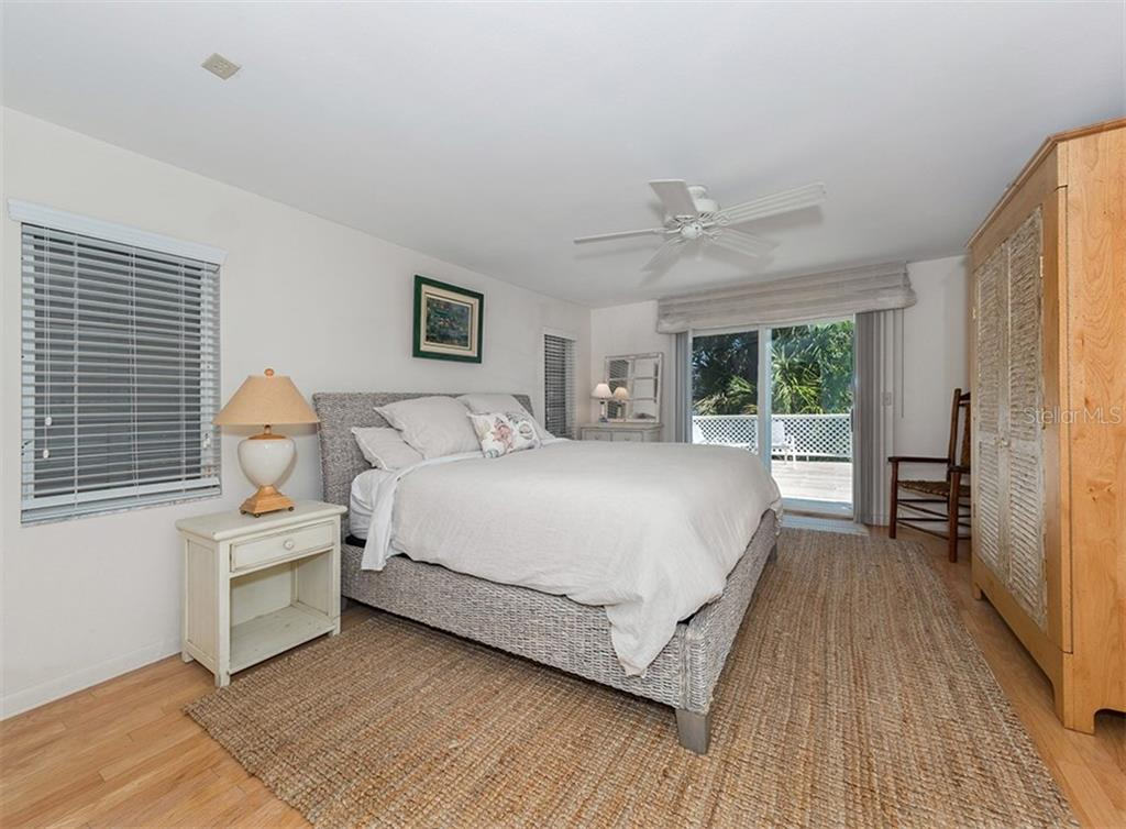 Master suite also offers views of the pool and bay. - Single Family Home for sale at 3509 Casey Key Rd, Nokomis, FL 34275 - MLS Number is N5915098