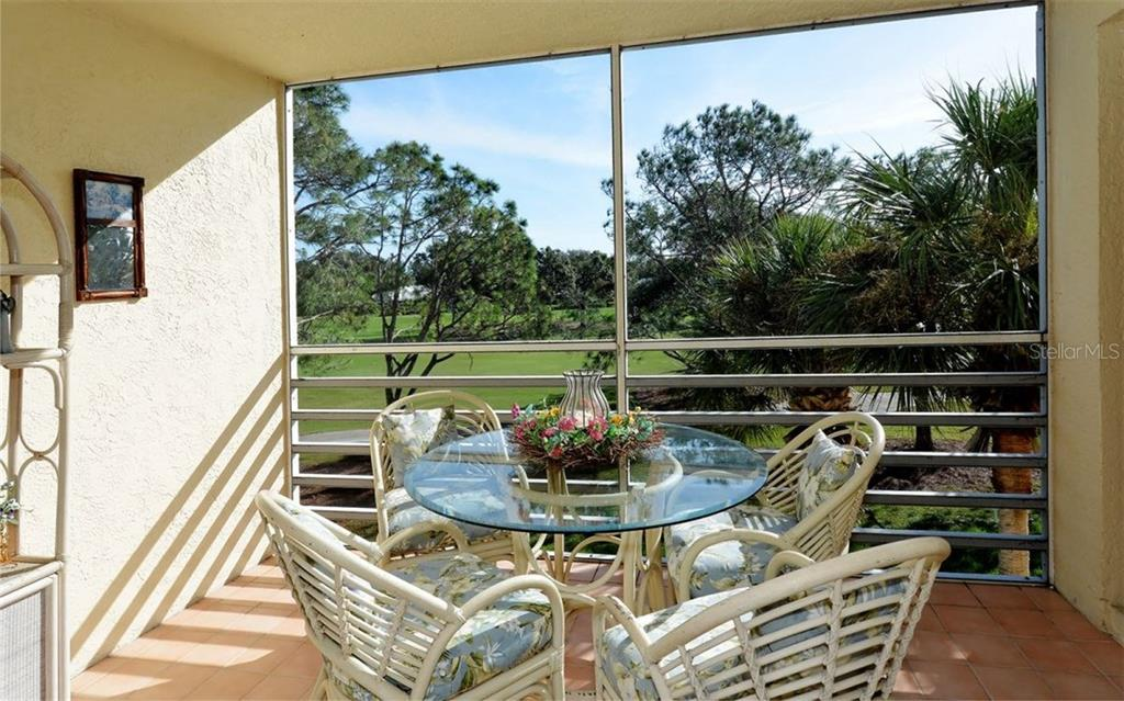 Lanai with view of golf course - Condo for sale at 1036 Wexford Blvd #1036, Venice, FL 34293 - MLS Number is N5915474