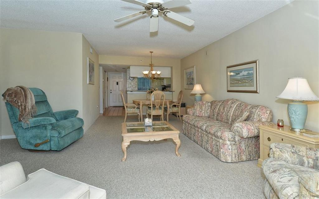 Living room to dining room, kitchen and entry - Condo for sale at 1036 Wexford Blvd #1036, Venice, FL 34293 - MLS Number is N5915474