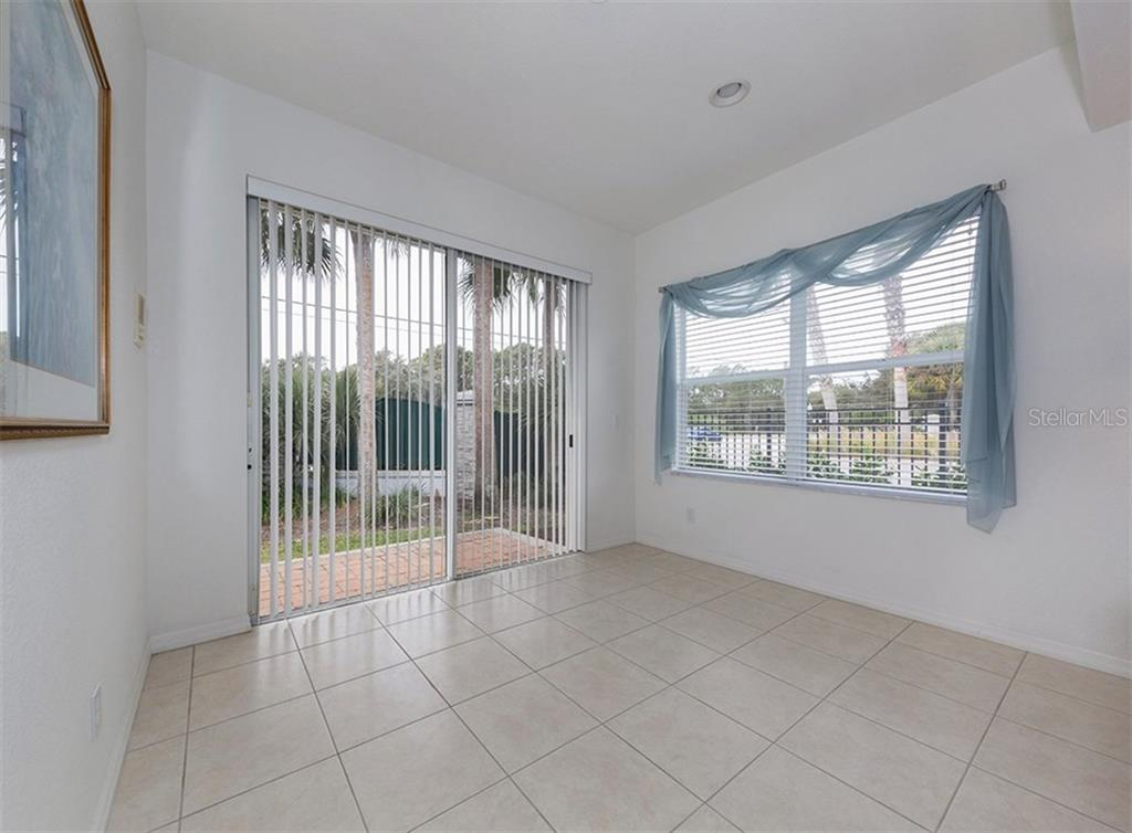 Florida room with sliders to patio - Villa for sale at 900 Onager Ct, Englewood, FL 34223 - MLS Number is N5915910