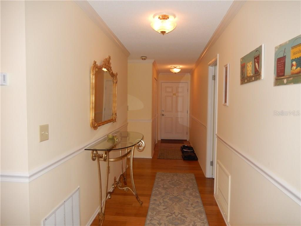 Entry foyer, new bamboo flooring, updated paneled doors throughout. - Condo for sale at 500 The Esplanade N #102, Venice, FL 34285 - MLS Number is N5915924