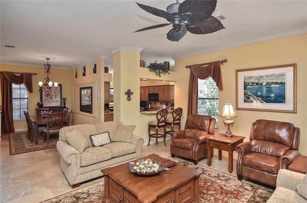 Living room/kitchen/dining room - Single Family Home for sale at 769 Sawgrass Bridge Rd, Venice, FL 34292 - MLS Number is N5916484