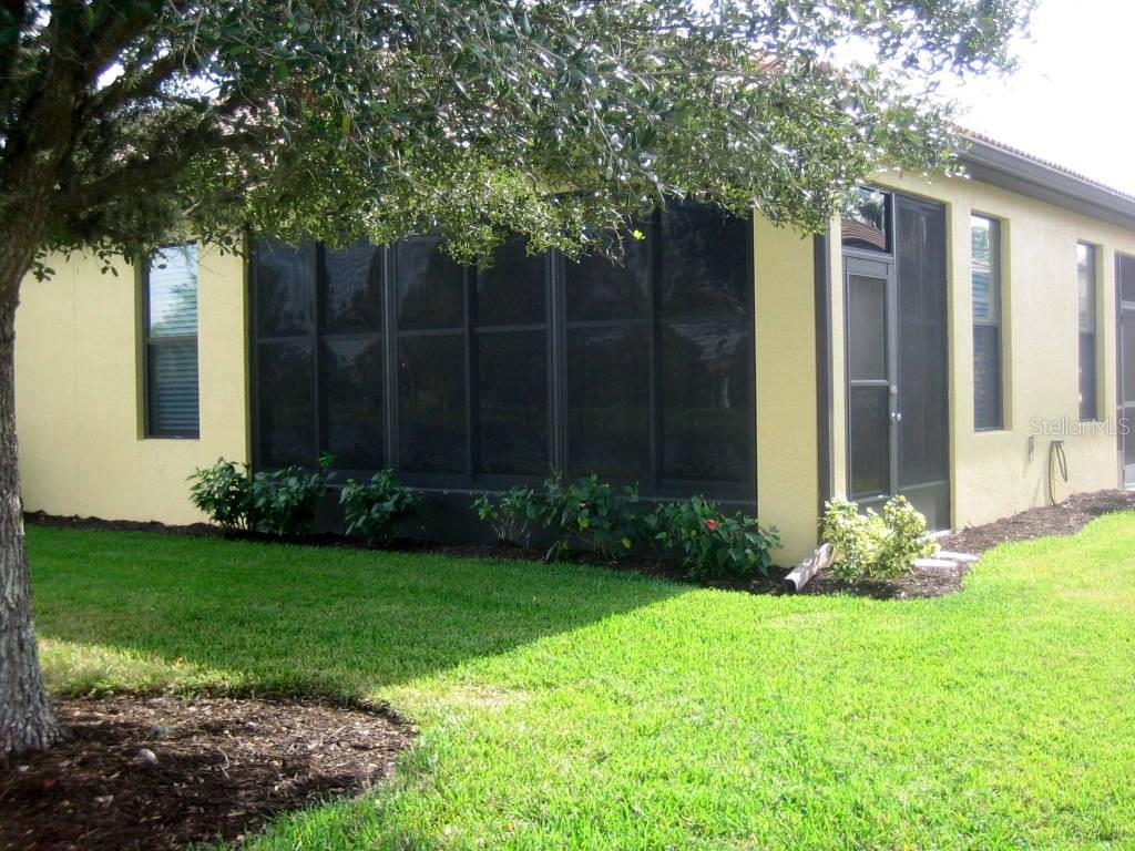 West side and back of villa - Villa for sale at 1445 Maseno Dr, Venice, FL 34292 - MLS Number is N5916837