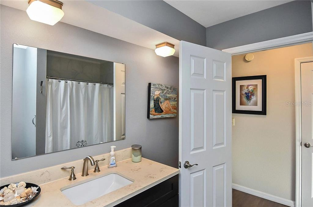 Spacious 2nd bath room - Single Family Home for sale at 405 Sunset Dr, Venice, FL 34285 - MLS Number is N5917234