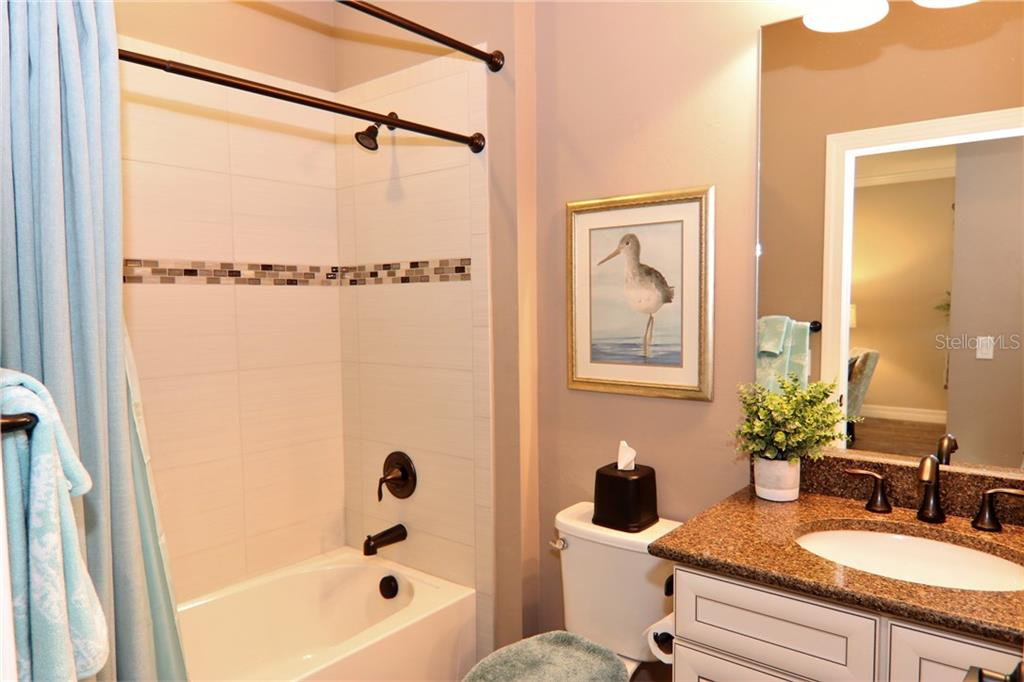 Guest bathroom with quartz counter top - Single Family Home for sale at 13880 Lido St, Venice, FL 34293 - MLS Number is N5917319