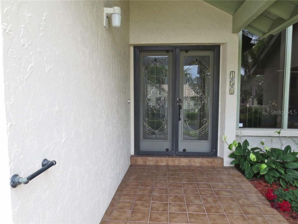 Front entry - Villa for sale at 151 Inlets Blvd #151, Nokomis, FL 34275 - MLS Number is N6100469