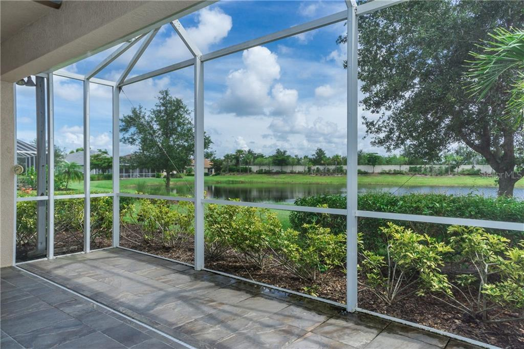 Lake View from Tiled Lanai - Single Family Home for sale at 2290 Terracina Dr, Venice, FL 34292 - MLS Number is N6101301
