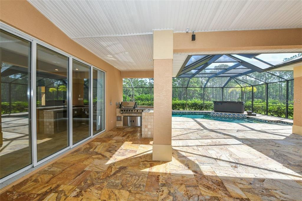 Lanai, outdoor kitchen, pool - Single Family Home for sale at 9150 Deer Ct, Venice, FL 34293 - MLS Number is N6101408