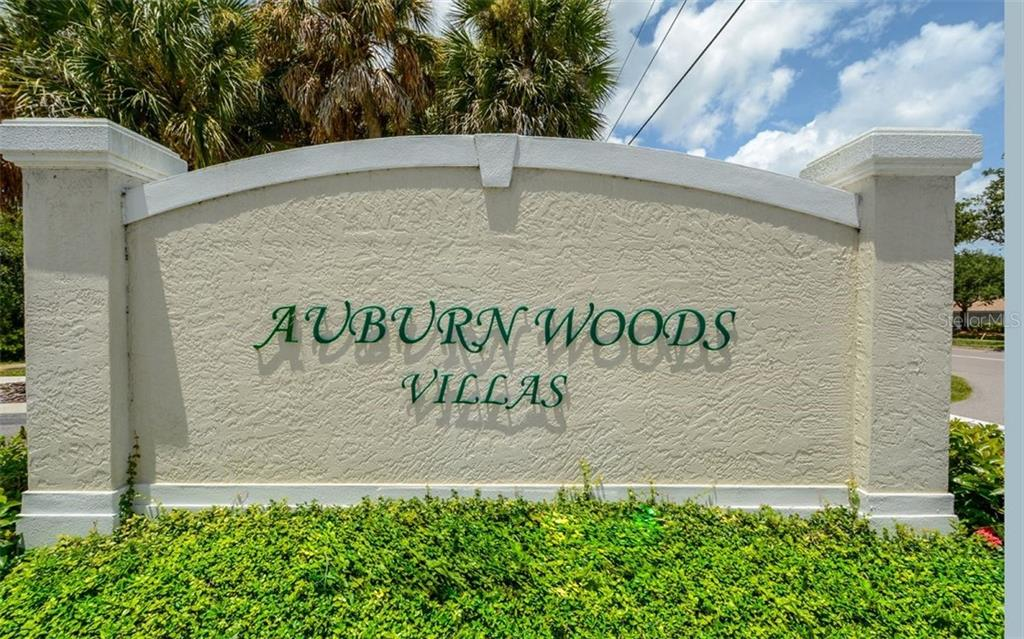 Community sign - Villa for sale at 313 Auburn Woods Cir, Venice, FL 34292 - MLS Number is N6101432