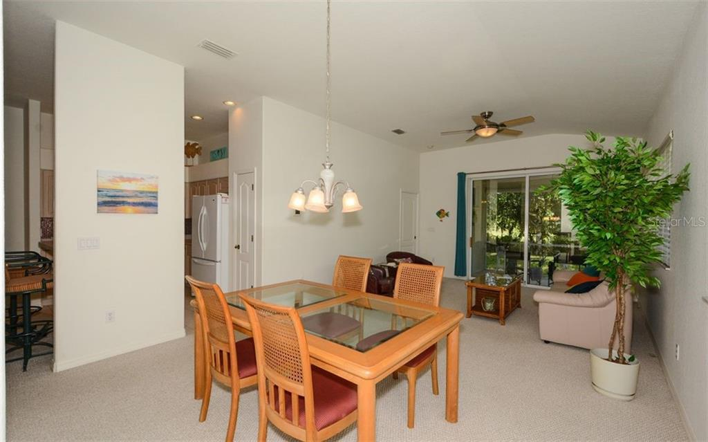 Dining area, great room - Villa for sale at 313 Auburn Woods Cir, Venice, FL 34292 - MLS Number is N6101432