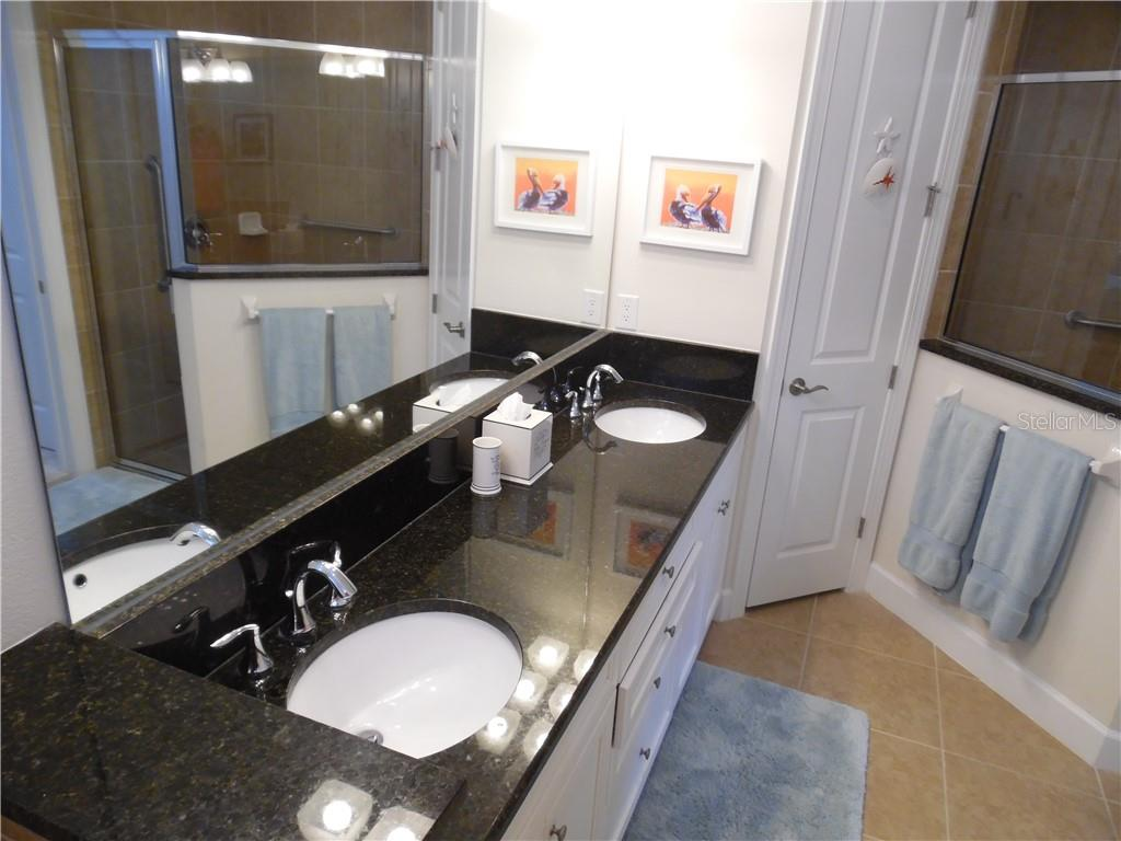 master bath room has dual sinks - Single Family Home for sale at 239 Nolen Dr, Venice, FL 34292 - MLS Number is N6101457