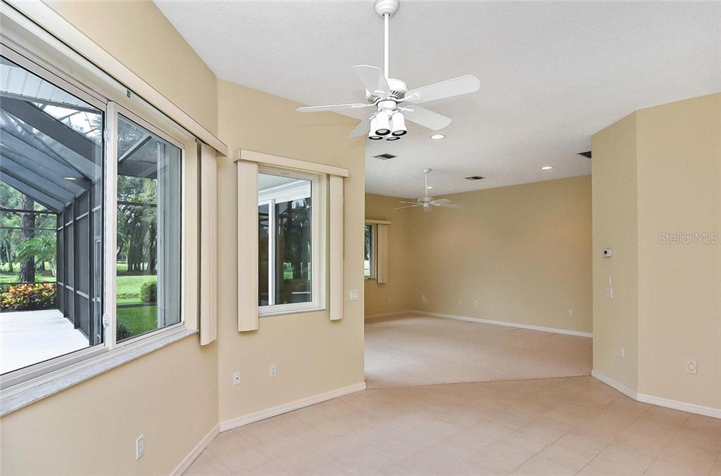 Family Room Virtually Staged - Single Family Home for sale at 2156 Muskogee Trl, Nokomis, FL 34275 - MLS Number is N6101745