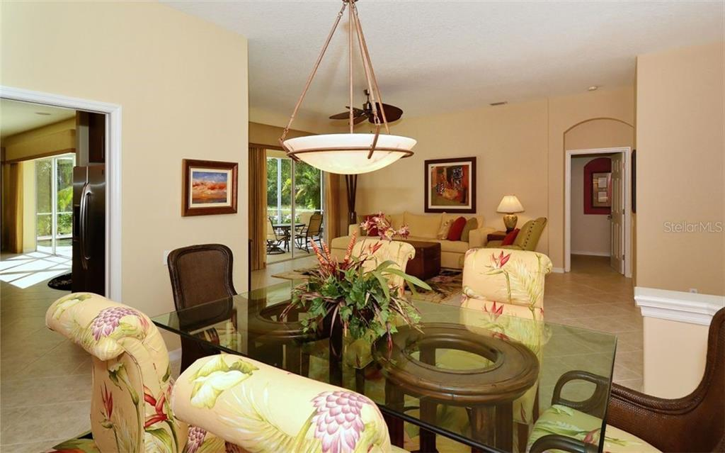 Dining room to living room - Single Family Home for sale at 913 Chickadee Dr, Venice, FL 34285 - MLS Number is N6101770