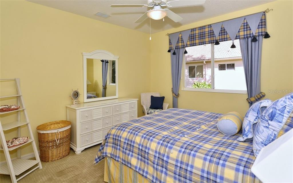 Bedroom 3 - Single Family Home for sale at 913 Chickadee Dr, Venice, FL 34285 - MLS Number is N6101770