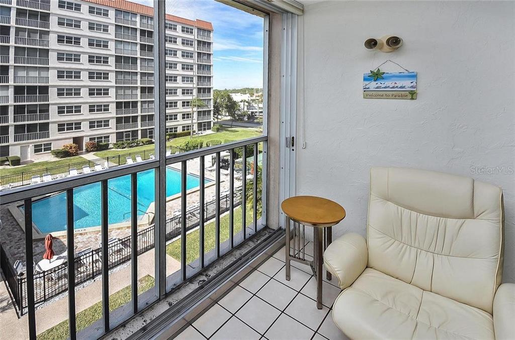Lanai with view of pool - Condo for sale at 232 Saint Augustine Ave #405, Venice, FL 34285 - MLS Number is N6101830