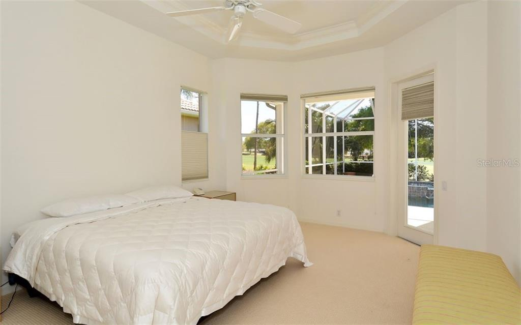 Master bedroom (includes custom closet system) - Single Family Home for sale at 1018 Grouse Way, Venice, FL 34285 - MLS Number is N6101913