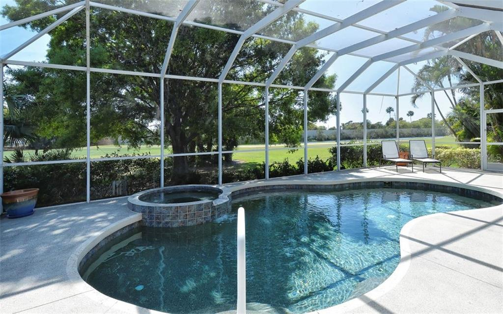 Heated pool and spa - Single Family Home for sale at 1018 Grouse Way, Venice, FL 34285 - MLS Number is N6101913