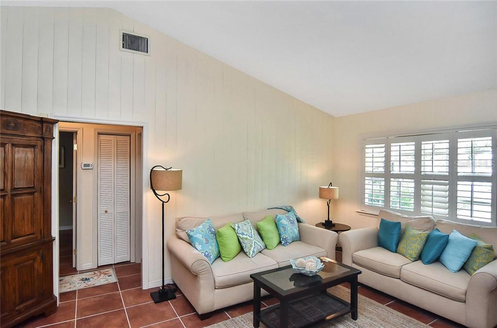 The doorway ahead leads to the two bedrooms and guest bath. - Single Family Home for sale at 316 Alba St E, Venice, FL 34285 - MLS Number is N6102095
