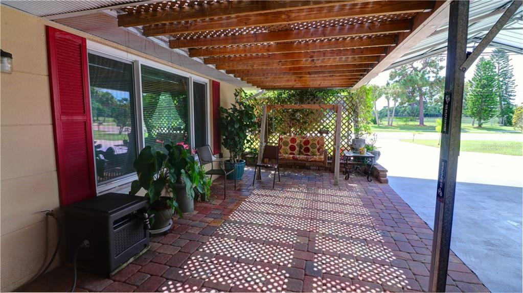 Lovely Pavered overhang for more room to enjoy the Venice FL Weather - Single Family Home for sale at 401 Shamrock Blvd, Venice, FL 34293 - MLS Number is N6102109