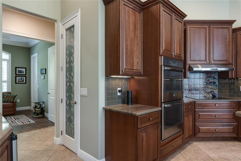 Kitchen to den/bedroom 3 - Single Family Home for sale at 633 Apalachicola Rd, Venice, FL 34285 - MLS Number is N6102111