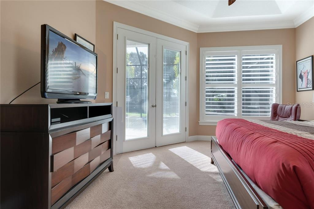 Master bedroom with French doors to pool - Single Family Home for sale at 633 Apalachicola Rd, Venice, FL 34285 - MLS Number is N6102111
