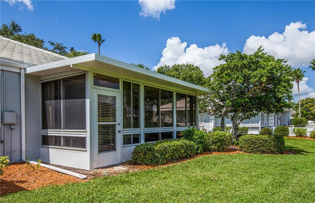 Carport storage and laundry room that connects to the front terrace. - Villa for sale at 206 Cerromar Way S #25, Venice, FL 34293 - MLS Number is N6102127