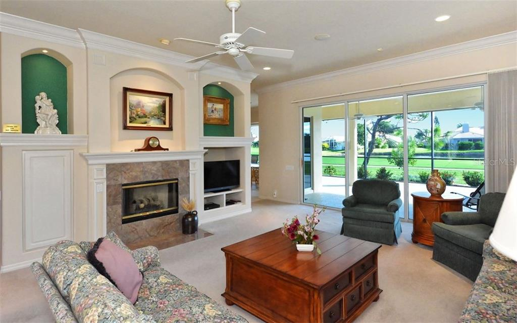 Great room with fireplace and entertainment center - Single Family Home for sale at 979 Chickadee Dr, Venice, FL 34285 - MLS Number is N6102266