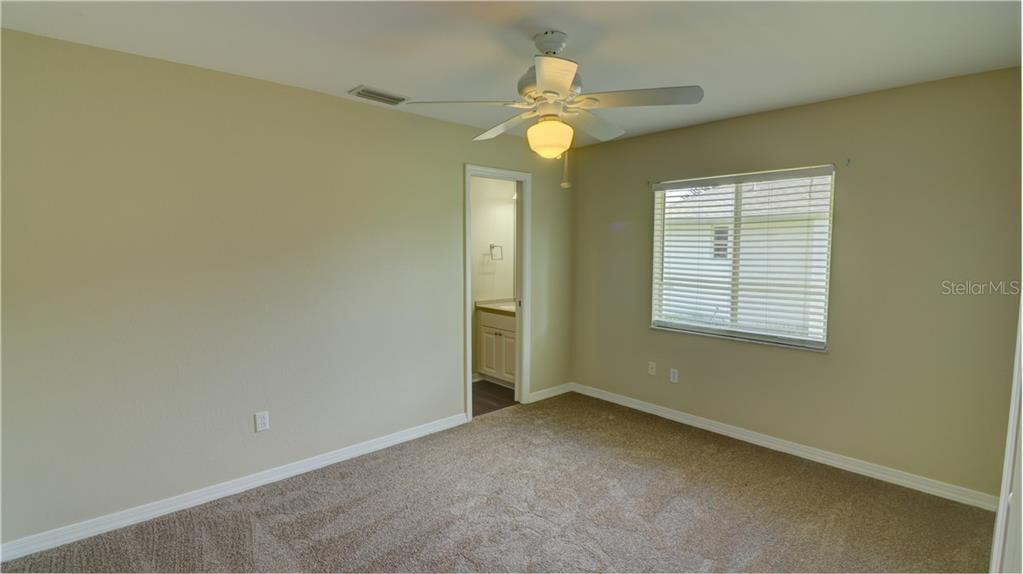 Bedroom 2 with private bathroom - Single Family Home for sale at 409 Palm Ave, Nokomis, FL 34275 - MLS Number is N6102313