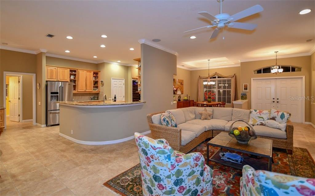 Interior:  foyer, great room, dining room and kitchen - Single Family Home for sale at 820 Adonis Pl, Venice, FL 34292 - MLS Number is N6102472