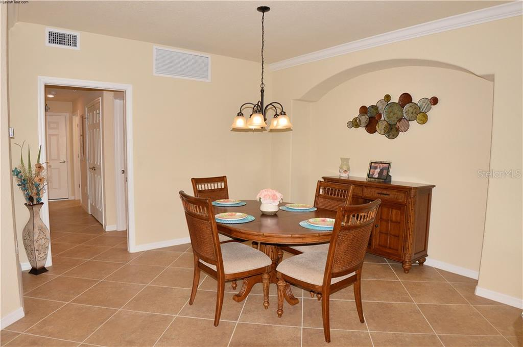 Dining room - Condo for sale at 20140 Ragazza Cir #102, Venice, FL 34293 - MLS Number is N6103394