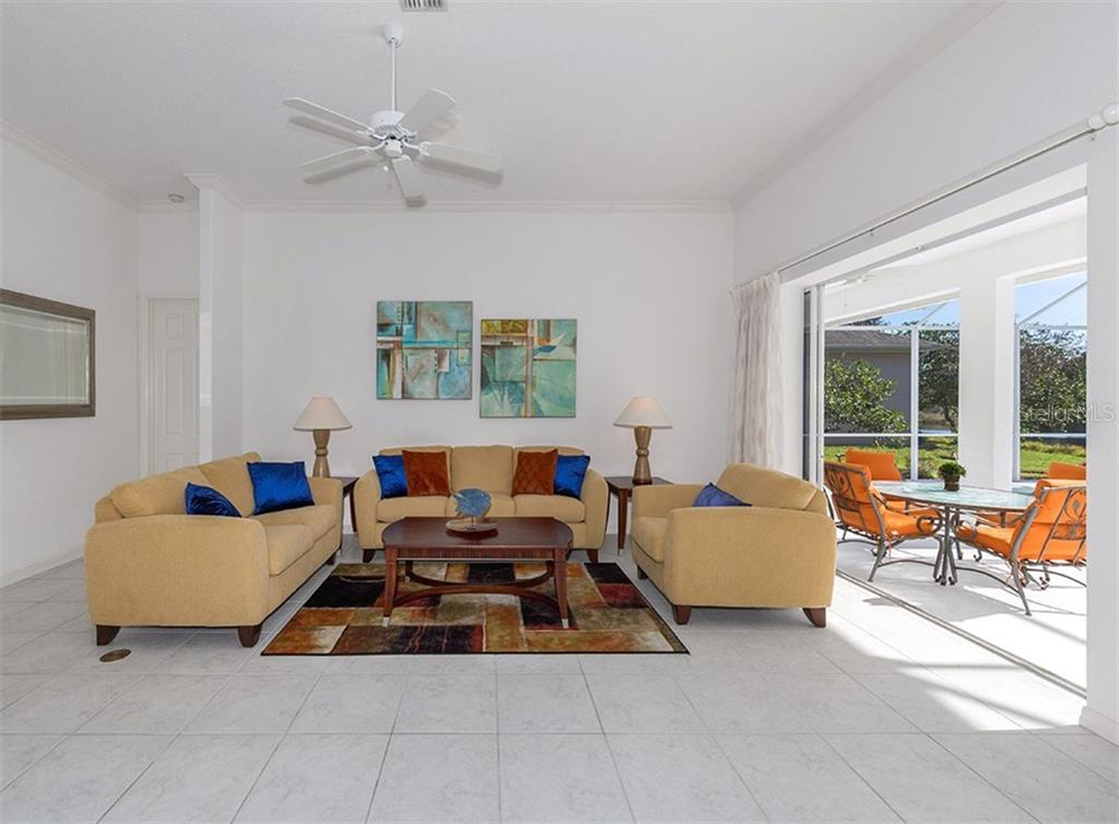 Living room with sliders to lanai and pool - Single Family Home for sale at 2201 Sonoma Dr E, Nokomis, FL 34275 - MLS Number is N6103410