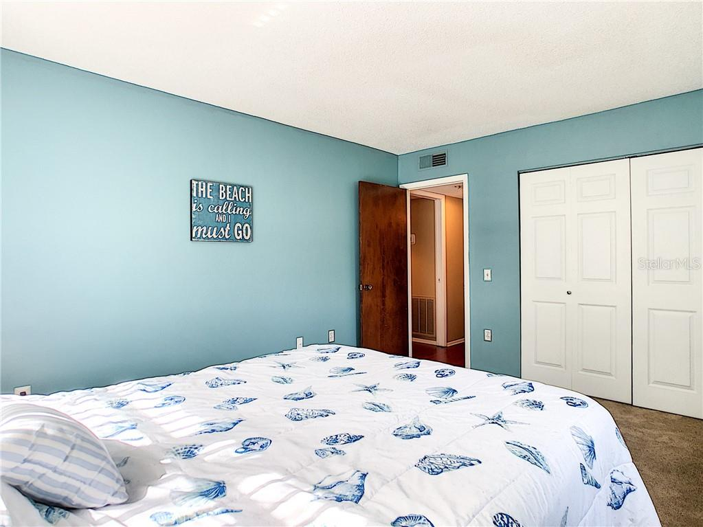 Bedroom 2 with large closet - Condo for sale at 211 Rubens Dr #h, Nokomis, FL 34275 - MLS Number is N6103629