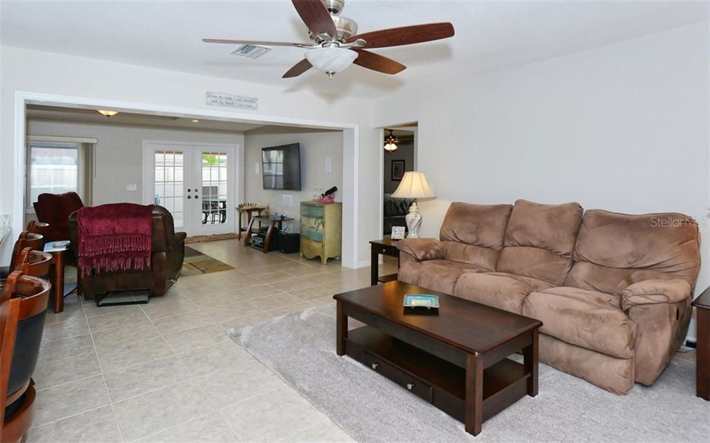 Living room to family room - Single Family Home for sale at 1460 Strada D Argento, Venice, FL 34292 - MLS Number is N6104612