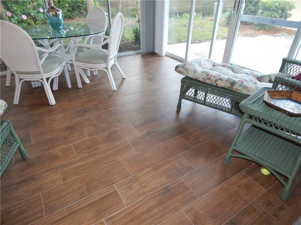 NEW WOOD LOOK TILE FLOORING- FLORIDA ROOM - Villa for sale at 572 Clubside Cir #34, Venice, FL 34293 - MLS Number is N6105221