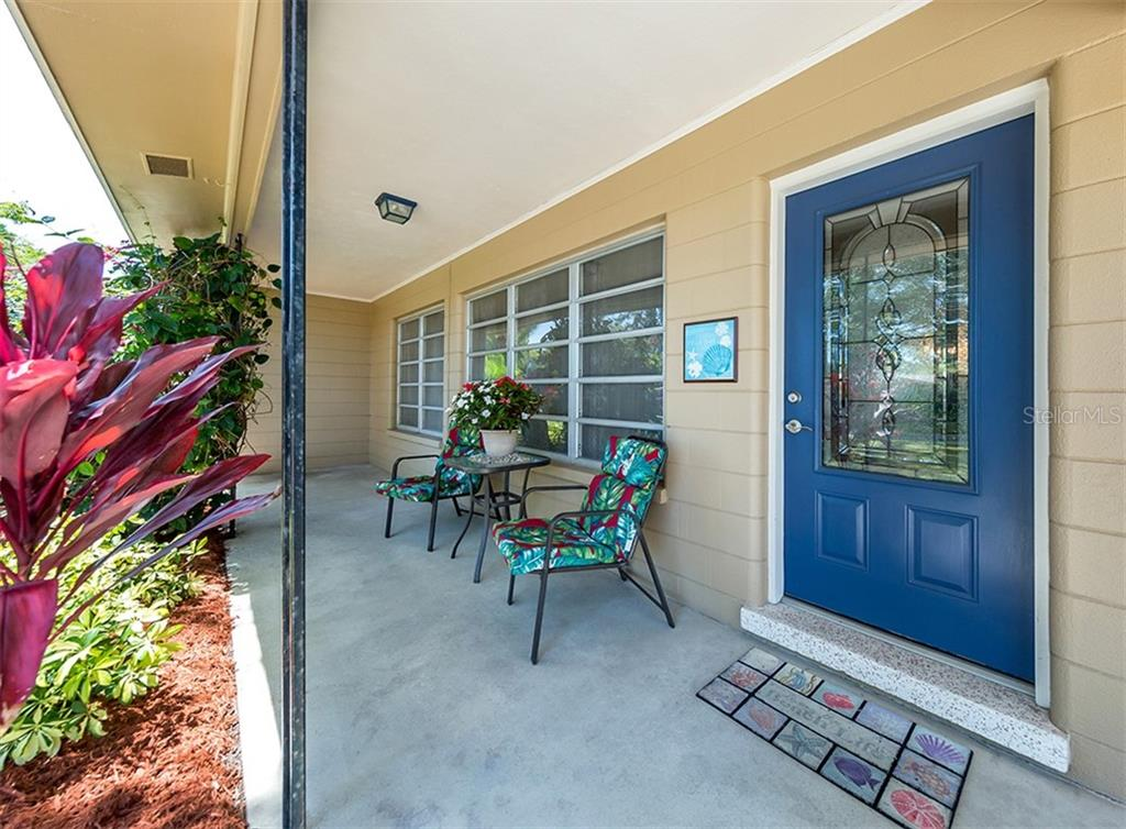 Enjoy the outdoor space under the covered porch - Single Family Home for sale at 109 Alba St W, Venice, FL 34285 - MLS Number is N6105330