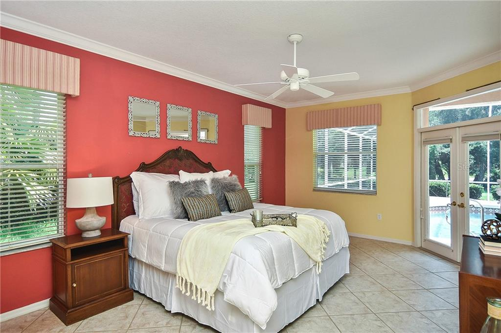 Master Bedroom with beautiful accent wall and tile floors - Single Family Home for sale at 322 Dulmer Dr, Nokomis, FL 34275 - MLS Number is N6105498