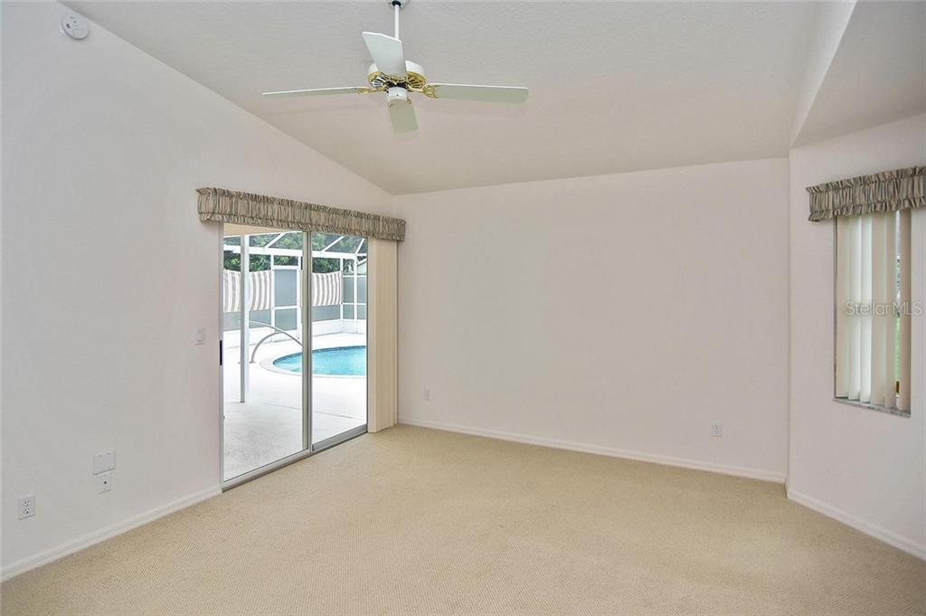 Master bedroom with sliders to pool - Single Family Home for sale at 2232 E Village Cir, Venice, FL 34293 - MLS Number is N6105697
