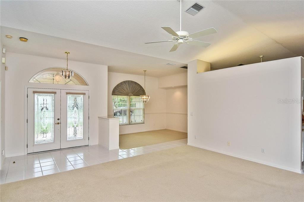 Great room to foyer and dining room - Single Family Home for sale at 2232 E Village Cir, Venice, FL 34293 - MLS Number is N6105697