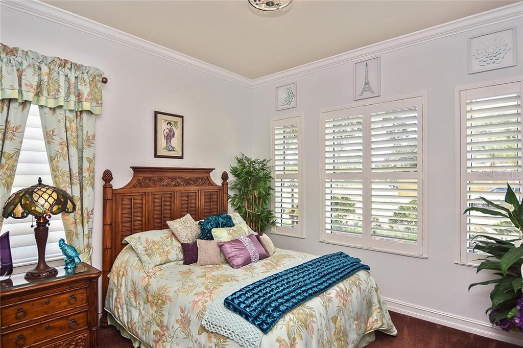 Bedroom 2 - Single Family Home for sale at 753 Guild Dr, Venice, FL 34285 - MLS Number is N6105757