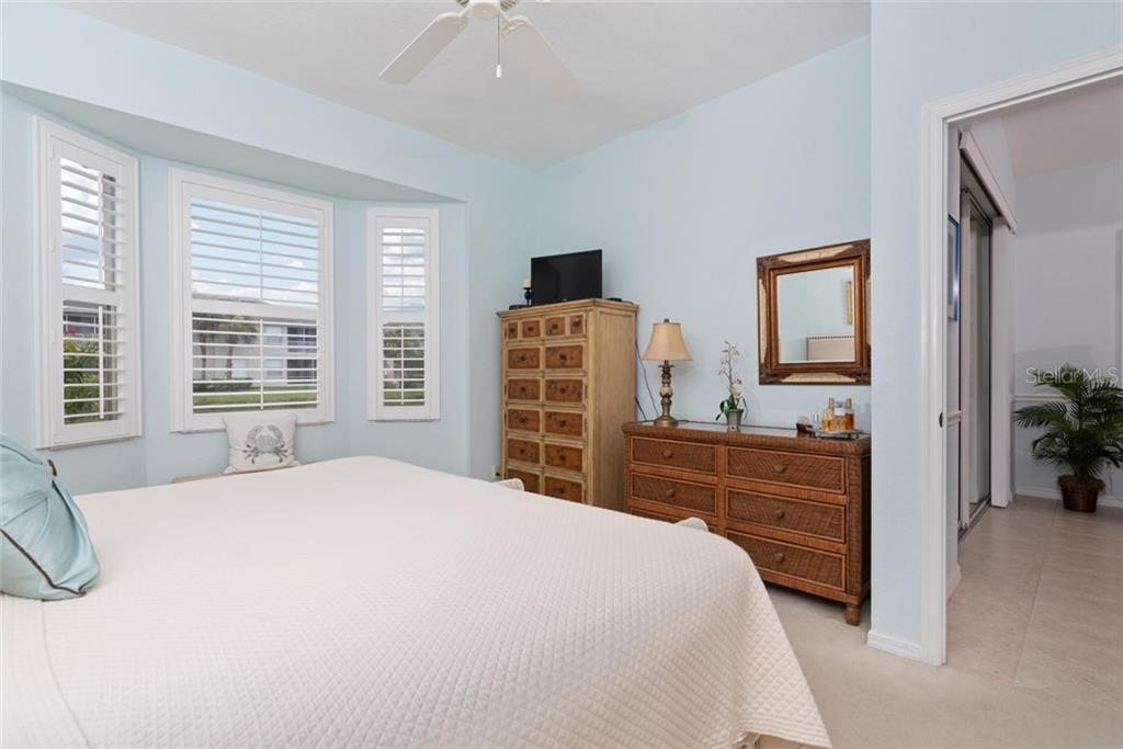 Master bedroom to living room - Villa for sale at 1708 Fountain View Cir, Venice, FL 34292 - MLS Number is N6106422