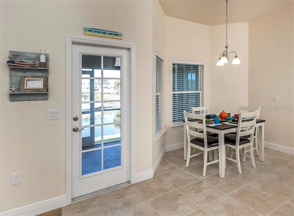 Breakfast nook to lanai - Single Family Home for sale at 10449 Redondo St, Port Charlotte, FL 33981 - MLS Number is N6107406