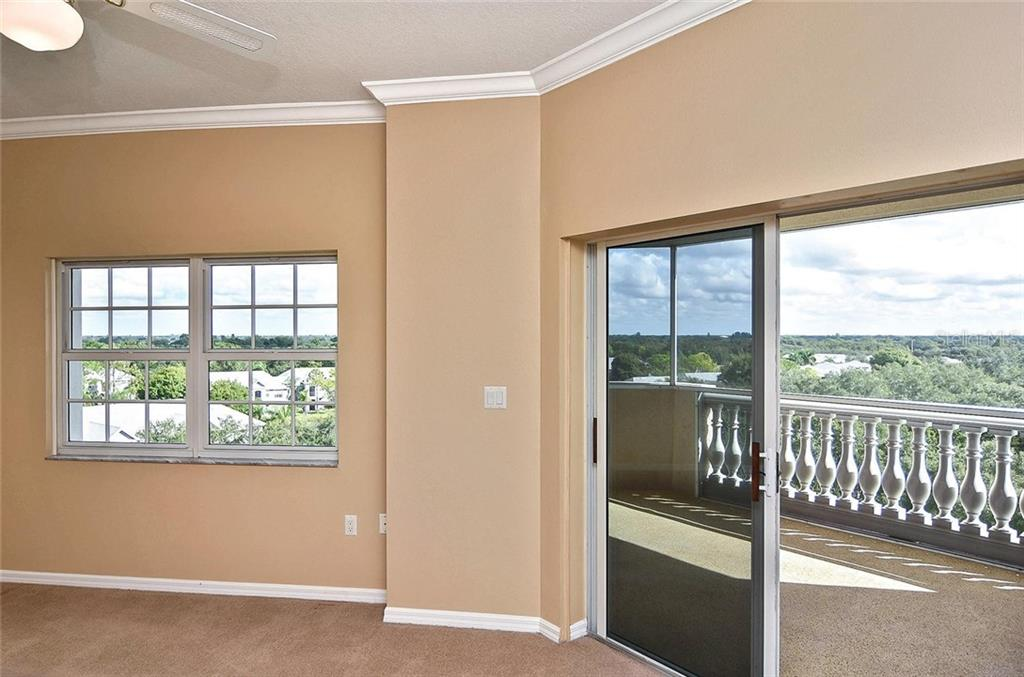 Living room with slider to balcony - Condo for sale at 3730 Cadbury Cir #614, Venice, FL 34293 - MLS Number is N6107624