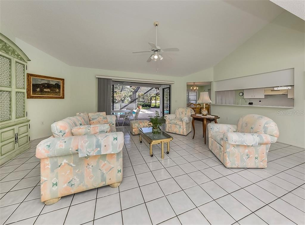 Living room with sliders to pool - Single Family Home for sale at 1569 Vermeer Dr, Nokomis, FL 34275 - MLS Number is N6108096