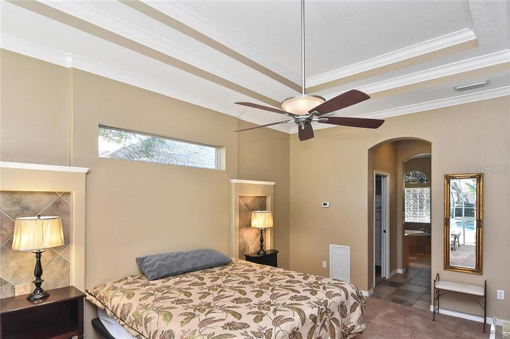 Master bedroom to master bath - Single Family Home for sale at 321 Dulmer Dr, Nokomis, FL 34275 - MLS Number is N6108685