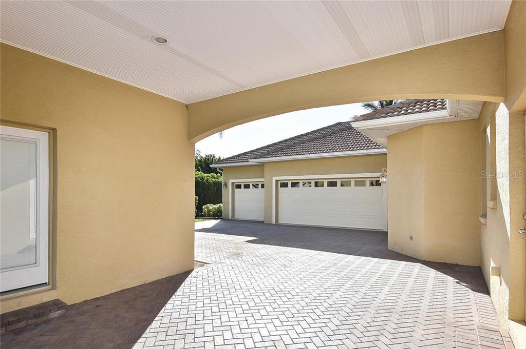 Driveway to 3 stall garage - Single Family Home for sale at 321 Dulmer Dr, Nokomis, FL 34275 - MLS Number is N6108685