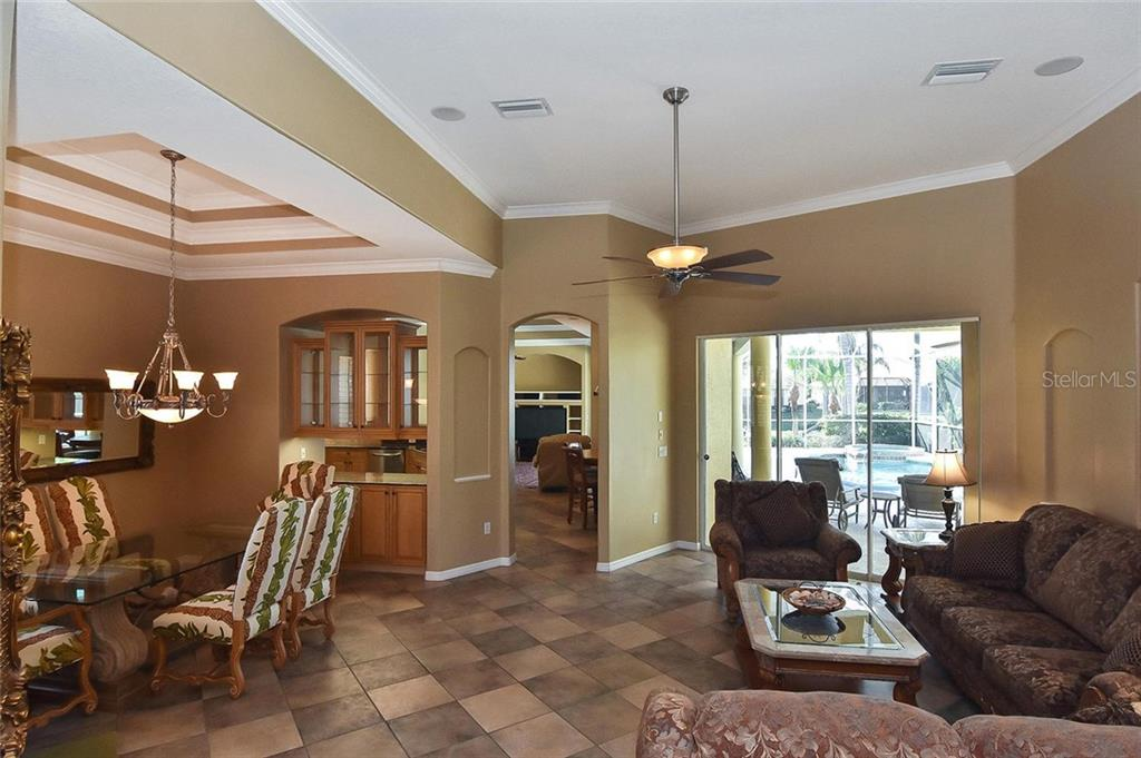 Living room, dining room - Single Family Home for sale at 321 Dulmer Dr, Nokomis, FL 34275 - MLS Number is N6108685