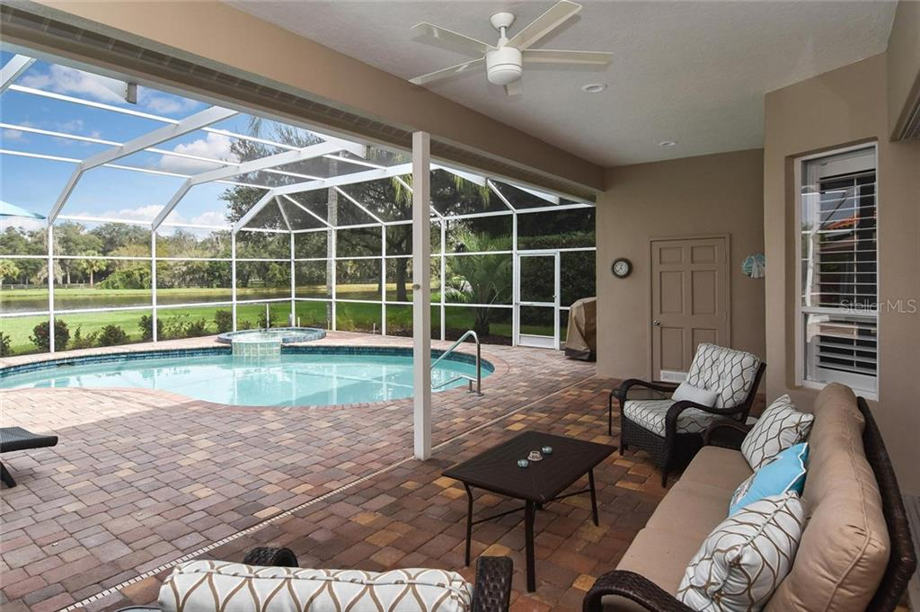 The house is beautiful, but see this - a saltwater heated pool with lake view! - Single Family Home for sale at 7185 N Serenoa Dr, Sarasota, FL 34241 - MLS Number is N6109058
