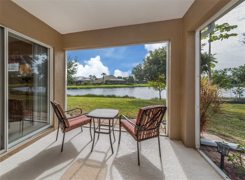 Lanai with water view - Single Family Home for sale at 5272 Layton Dr, Venice, FL 34293 - MLS Number is N6109077