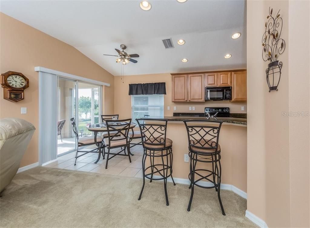 Breakfast bar, kitchen, dinette - Single Family Home for sale at 5272 Layton Dr, Venice, FL 34293 - MLS Number is N6109077
